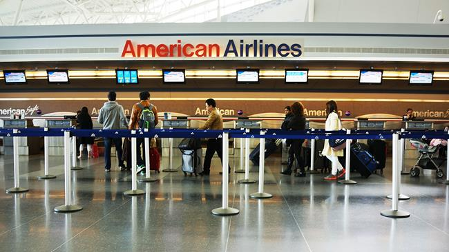 Retractable belt stanchions at American Airlines baggage check